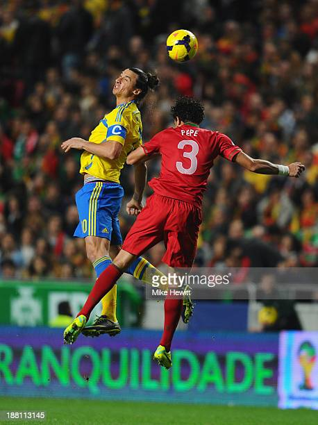 Zlatan Ibrahimovich of Sweden gets above Pepe of Portugal during the FIFA 2014 World Cup Qualifier Playoff First Leg between Portugal and Sweden at...