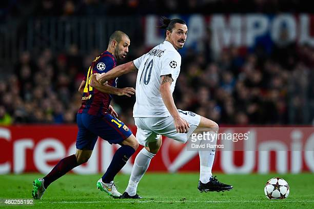 Zlatan Ibraimovic of Paris SaintGermain FC competes for the ball with Javier Mascherano of FC Barcelona during prior to the UEFA Champions League...