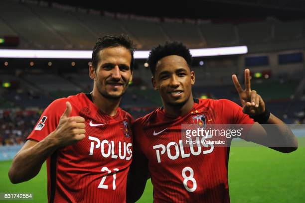 Zlatan Ljubijankic and Rafael Silva of Urawa Red Diamonds celebrate after the Suruga Bank Championship match between Urawa Red Diamonds and...