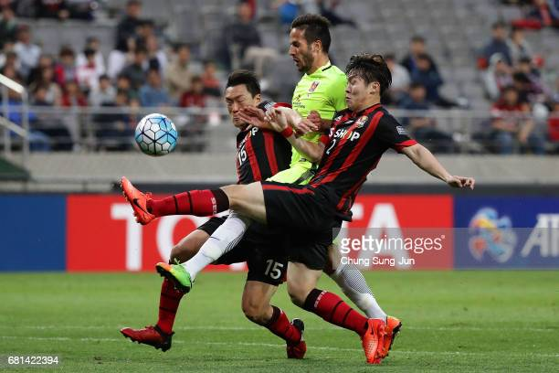 Zlatan Ljubijankic of Urawa Red competes for the nall with Hwang HyunSoo and Kim Won Sik of FC Seoul during the AFC Asian Champions League Group F...