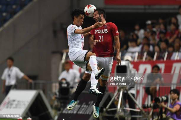 Zlatan Ljubijankic of Urawa Red Diamonds and Hiroyuki Komoto of Omiya Ardija compete for the ball during the JLeague J1 match between Urawa Red...