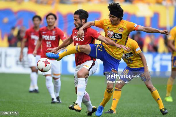 Zlatan Ljubijankic of Urawa Red Diamonds and Kazuki Oiwa of Vegalta Sendai compete for the ball during the JLeague J1 match between Vegalta Sendai...