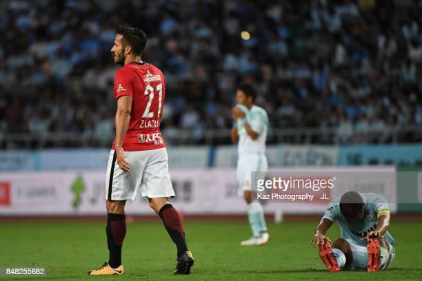 Zlatan Ljubijankic of Urawa Red Diamonds and Kentaro Oi of Jubilo Iwata react after the 11 draw in the JLeague J1 match between Jubilo Iwata and...