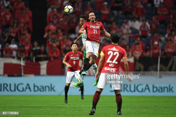 Zlatan Ljubijankic of Urawa Red Diamonds and Lucas Mineiro of Chapecoense compete for the ball during the Suruga Bank Championship match between...
