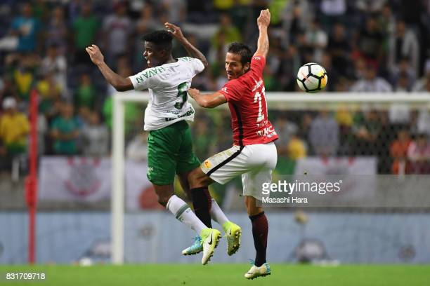 Zlatan Ljubijankic of Urawa Red Diamonds and Moises Ribeiro of Chapecoense compete for the ball during the Suruga Bank Championship match between...