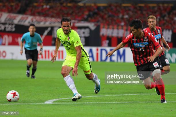 Zlatan Ljubijankic of Urawa Red Diamonds and Naoya Kikuchi of Consadole Sapporo compete for the ball during the JLeague J1 match between Consadole...