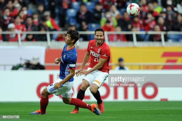 Zlatan Ljubijankic of Urawa Red Diamonds and Park Jeongsu of Yokohama FMarinos compete for the ball during the JLeague J1 match between Urawa Red...