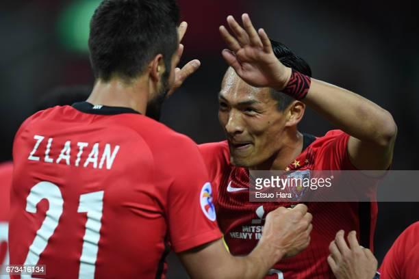 Zlatan Ljubijankic of Urawa Red Diamonds celebrates scoring his team's second goal with his team mate Tomoaki Makino during the AFC Champions League...
