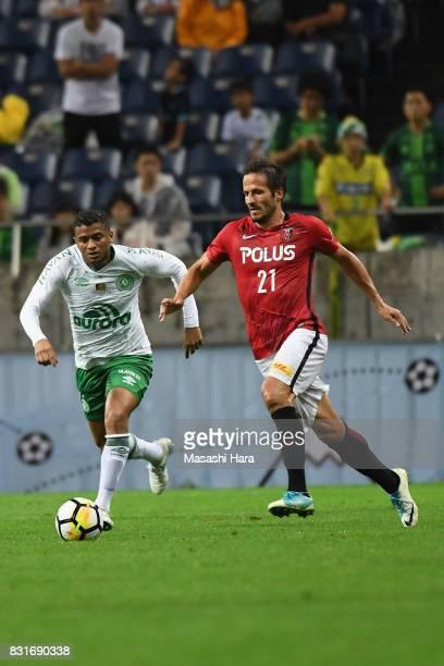Zlatan Ljubijankic of Urawa Red Diamonds controls the ball under pressure of Reinaldo of Chapecoense during the Suruga Bank Championship match...