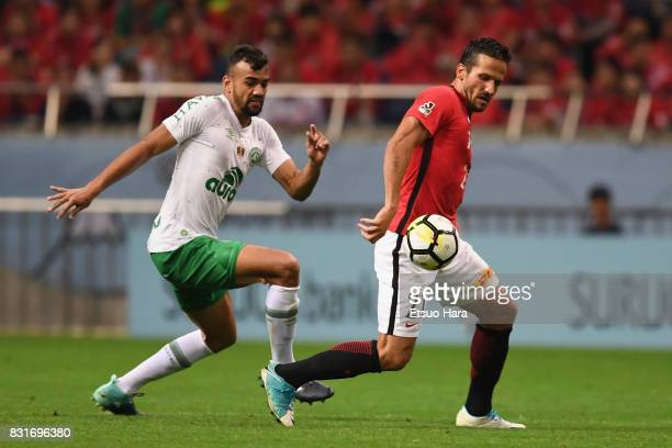 Zlatan Ljubijankic of Urawa Red Diamonds controls the ball under pressure of Fabricio Bruno of Chapecoense during the Suruga Bank Championship match...