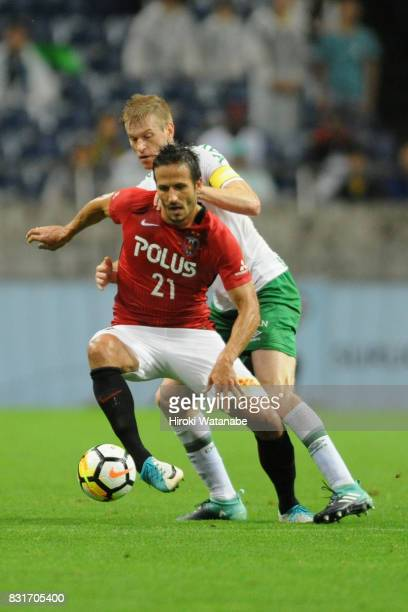 Zlatan Ljubijankic of Urawa Red Diamonds controls the ball under pressure of Grolli of Chapecoense during the Suruga Bank Championship match between...