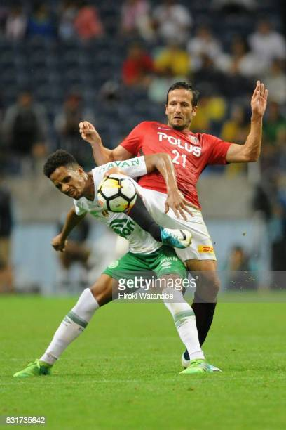 Zlatan Ljubijankic of Urawa Red Diamonds controls the ball under pressure of Lucas Mineiro of Chapecoense during the Suruga Bank Championship match...