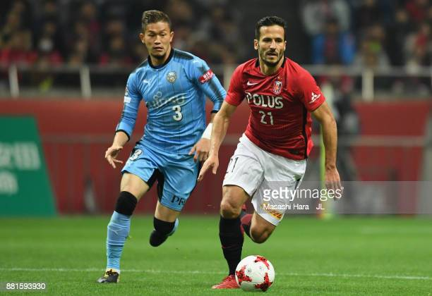 Zlatan Ljubijankic of Urawa Red Diamonds controls the ball under pressure of Tatsuki Nara of Kawasaki Frontale during the JLeague J1 match between...