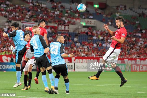 Zlatan Ljubijankic of Urawa Red Diamonds heads to score his side's second goal during the AFC Champions League quarter final second leg match between...