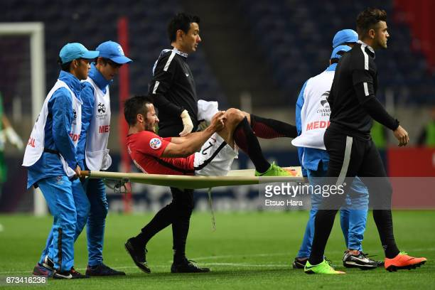 Zlatan Ljubijankic of Urawa Red Diamonds is carried injured off the pitch during the AFC Champions League Group F match between Urawa Red Diamonds...