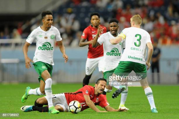 Zlatan Ljubijankic of Urawa Red Diamonds is challenged by Chapecoense defense during the Suruga Bank Championship match between Urawa Red Diamonds...