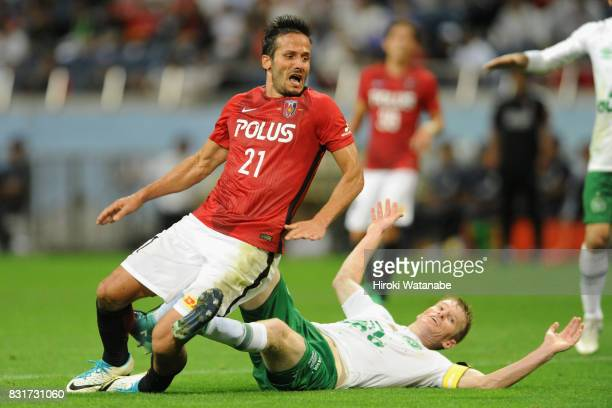 Zlatan Ljubijankic of Urawa Red Diamonds is challenged by Grolli of Chapecoense in the box resulting in a penalty kick during the Suruga Bank...