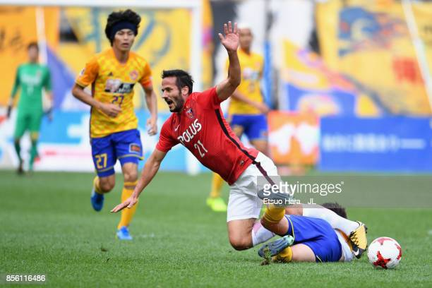 Zlatan Ljubijankic of Urawa Red Diamonds is challenged by Hiroaki Okuno of Vegalta Sendai during the JLeague J1 match between Vegalta Sendai and...