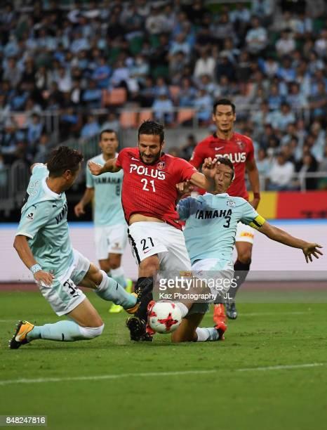 Zlatan Ljubijankic of Urawa Red Diamonds is challenged by Shun Morishita and Kentaro Oi of Jubilo Iwata during the JLeague J1 match between Jubilo...