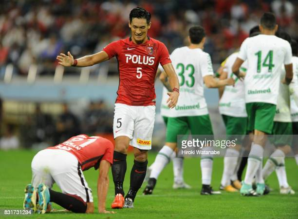 Zlatan Ljubijankic of Urawa Red Diamonds is congratulated by Tomoaki Makino after awarded a penalty kick while Chapecoense players protest during the...