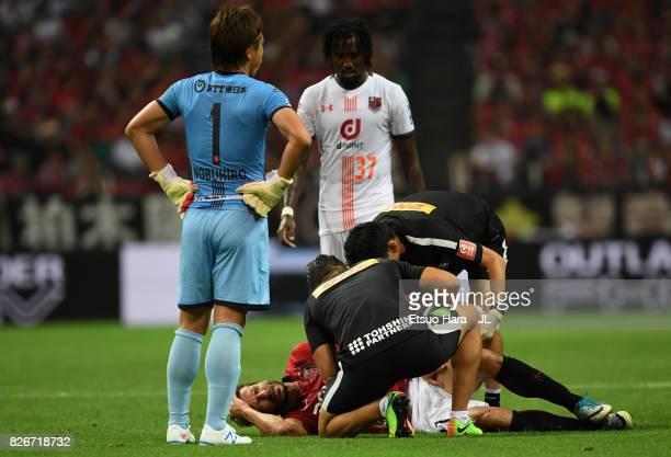 Zlatan Ljubijankic of Urawa Red Diamonds lies injured during the JLeague J1 match between Urawa Red Diamonds and Omiya Ardija at Saitama Stadium on...