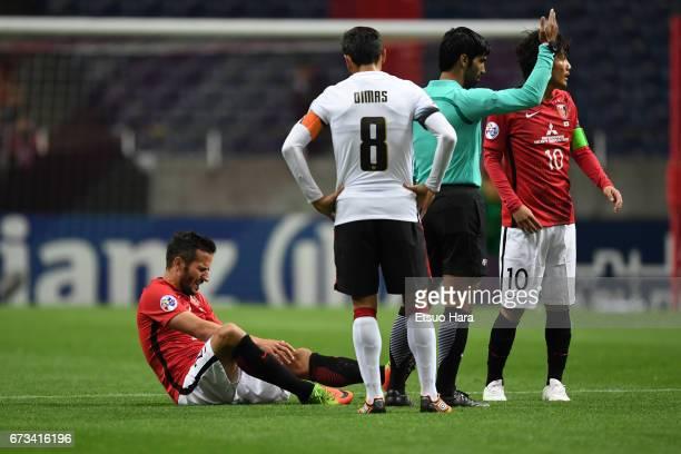 Zlatan Ljubijankic of Urawa Red Diamonds lies injured on the pitch during the AFC Champions League Group F match between Urawa Red Diamonds and...
