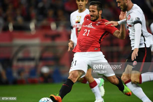 Zlatan Ljubijankic of Urawa Red Diamonds scores his team's second goal during the AFC Champions League Group F match between Urawa Red Diamonds and...