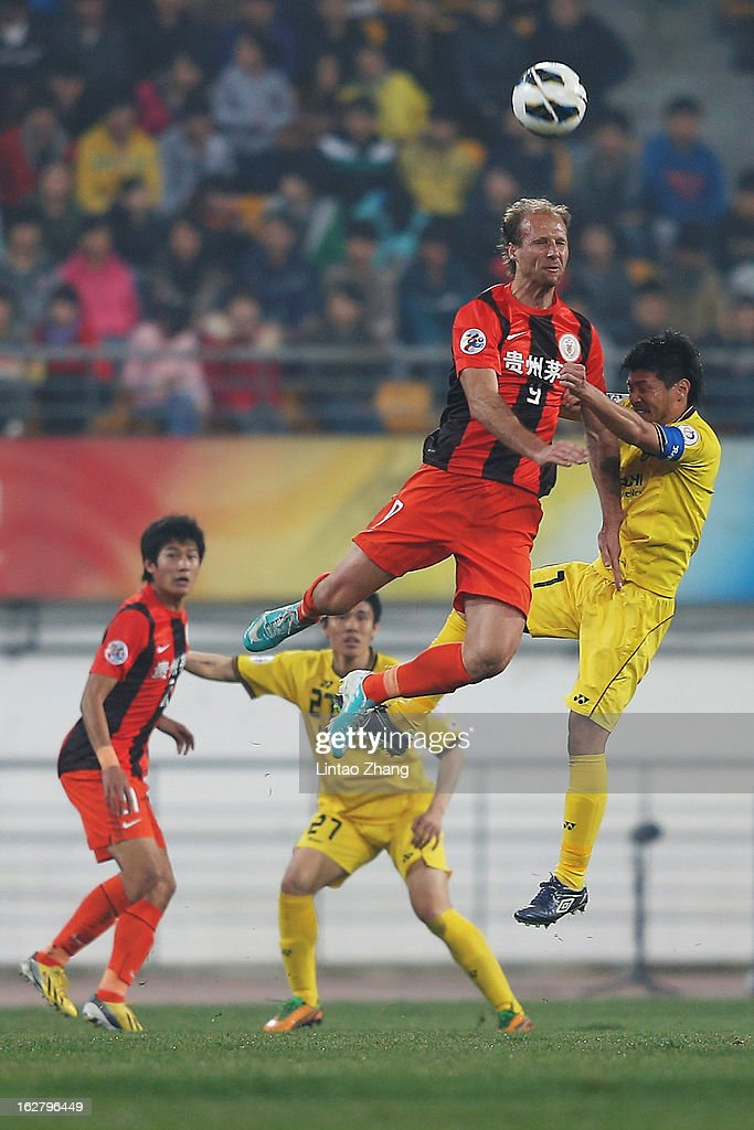 Zlatan Muslimovic (#9) of Guizhou Renhe competes for an aerial ball with Otani of Kashiwa Reysol during the AFC Champions League match between Guizhou Renhe and Kashiwa Reysol at Olympic Sports Center on February 27, 2013 in Guiyang, China.