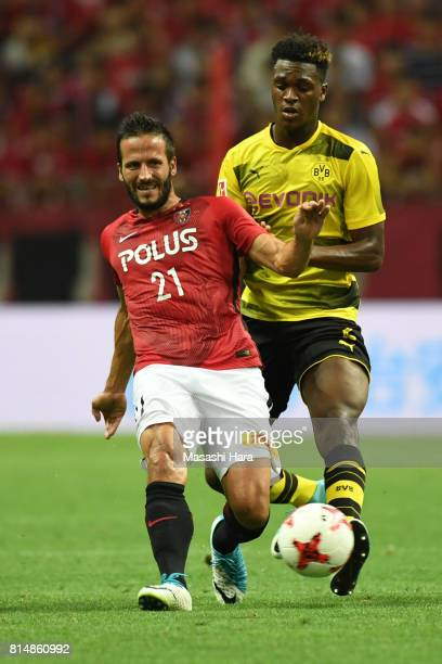 Zlatan of Urawa Red Diamonds and DanAxel Zagadou of Borussia Dortmund compete for the ball during the preseason friendly match between Urawa Red...