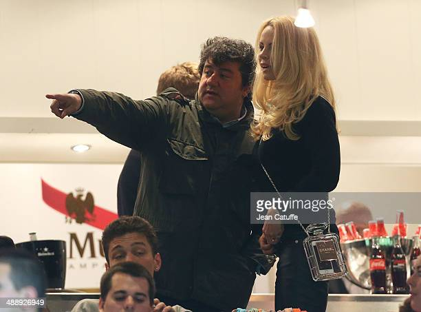 Zlatan's agent Mino Raiola and Zlatan's wife Helena Seger Ibrahimovic holding a Chanel Perfume Bottle Clutch attend the french Ligue 1 match between...