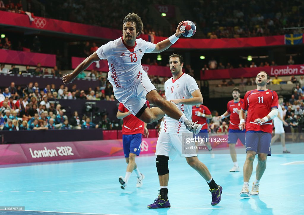 Zlatko Horvat of Croatia shoots and scores during the Men's Handball Preliminary match between Serbia and Croatia on Day 4 of the London 2012 Olympic Games at The Copper Box on July 31, 2012 in London, England.