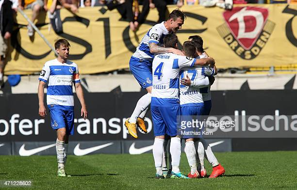 Zlatko Janijc of Duisburg jubilates with team mates after scoring the second goal after penalty during the third league match between SG Dynamo...