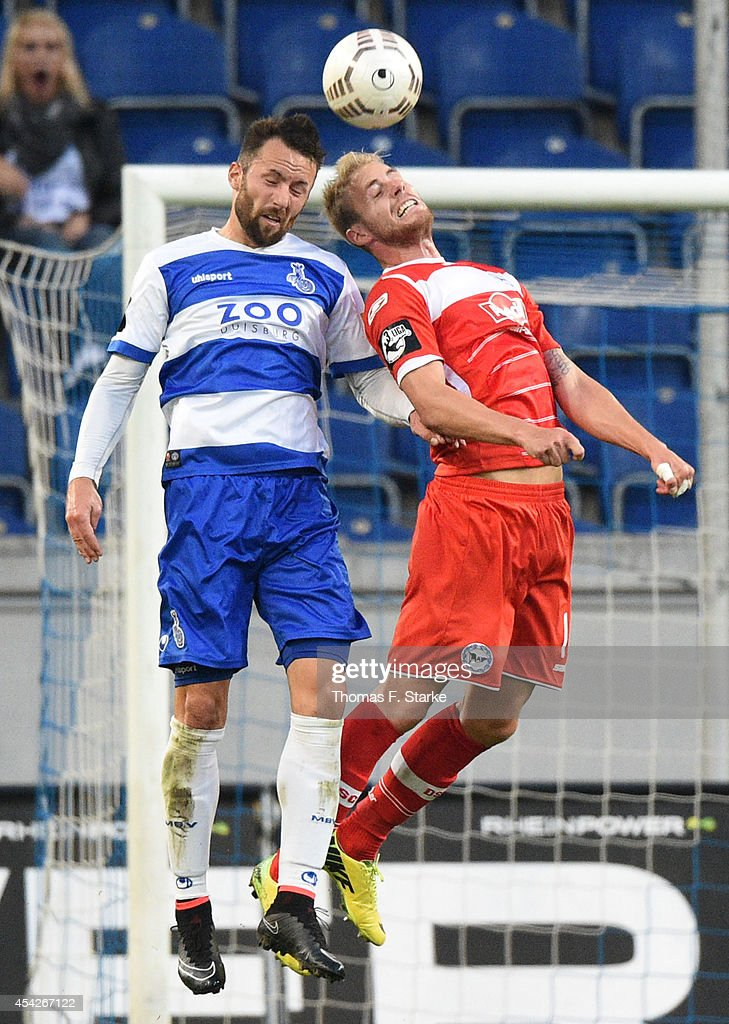 Zlatko Janjic (L) of Duisburg and Felix Burmeister of Bielefeld head for the ball during the Third League match between MSV Duisburg and Arminia Bielefeld at Schauinsland-Reisen-Arena on August 27, 2014 in Duisburg, Germany.