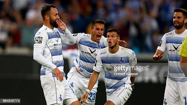 Zlatko Janjic of Duisburg celebrates the first goal with Fabian Schnellhardt and Andreas Wiegel during the Third League match between MSV Duisburg...