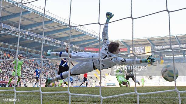 Zlatko Janjic of Duisburg scores his team's first goal against goalkeeper Alexander Schwolow of Bielefeld during the Third League match between...