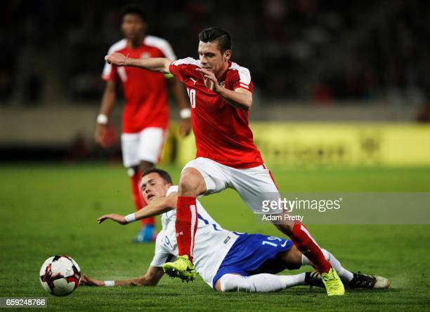 Zlatko Junuzovic of Austria is tackeld by Thomas Lam of Finland during the Austria v Finland International Friendly match at Tivoli Stadium on March...