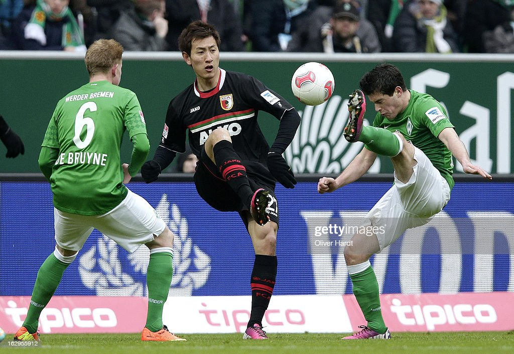 Zlatko Junuzovic (R) of Bremen and Dong Won Ji (L) of Augsburg battle for the ball during the Bundesliga match between SV Werder Bremen and FC Augsburg at Weser Stadium on March 2, 2013 in Bremen, Germany.