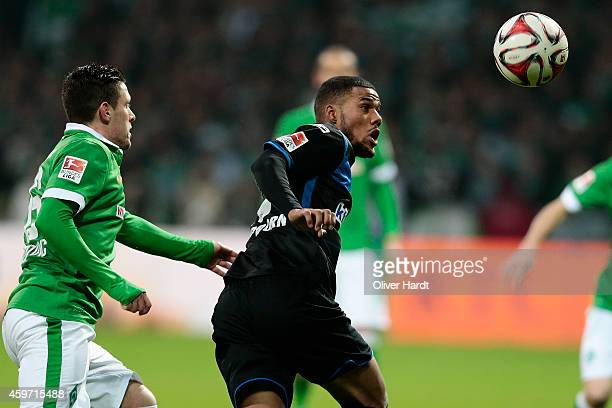 Zlatko Junuzovic of Bremen and Elias Kachunga of Paderborn compete for the ball during the First Bundesliga match between SV Werder Bremen and SC...