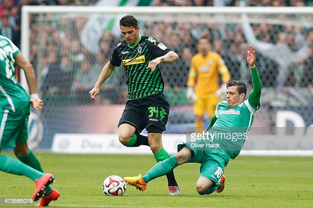 Zlatko Junuzovic of Bremen and Granit Xhaka of Moenchengladbach compete for the ball during the First Bundesliga match between SV Werder Bremen and...