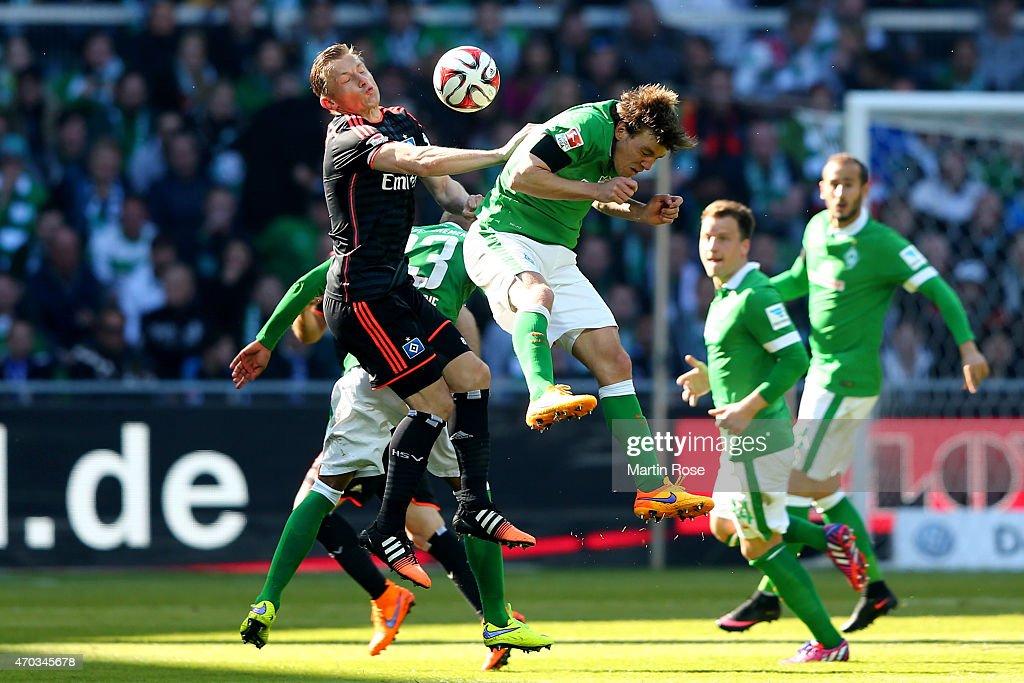 Zlatko Junuzovic of Bremen and Ivica Olic of Hamburg battle for the ball during the Bundesliga match between SV Werder Bremen and Hamburger SV at...