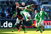 Zlatko Junuzovic of Bremen and Ivica Olic of Hamburg battle for the ball during the Bundesliga match between SV Werder Bremen and Hamburger SV at...