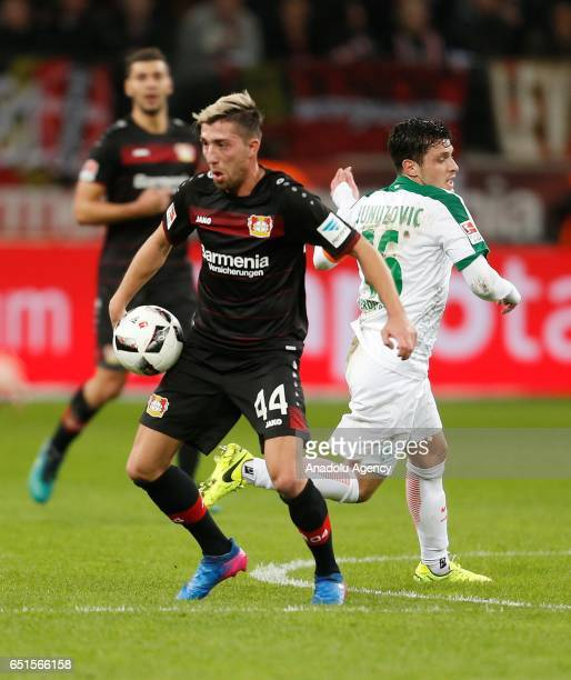 Zlatko Junuzovic of Bremen and Kevin Kampl of Leverkusen challenge with the ball during the Bundesliga soccer match between Bayer Leverkusen and...