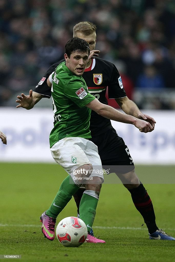 Zlatko Junuzovic (L) of Bremen and Ragnar Klavan (R) of Augsburg battle for the ball during the Bundesliga match between SV Werder Bremen and FC Augsburg at Weser Stadium on March 2, 2013 in Bremen, Germany.
