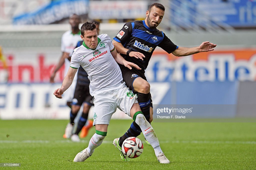 Zlatko Junuzovic of Bremen and Sueleyman Koc of Paderborn fight for the ball during the Bundesliga match between SC Paderborn and SV Werder Bremen at...