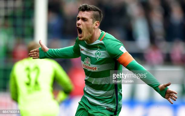 Zlatko Junuzovic of Bremen celebrates after scoring his teams first goal during the Bundesliga match between Werder Bremen and RB Leipzig at...