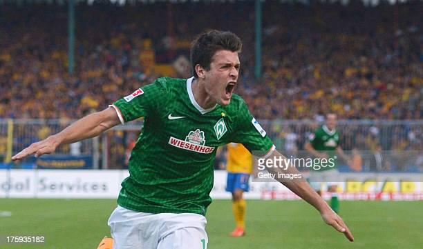 Zlatko Junuzovic of Bremen celebrates after scoring the opening goal of the Bundesliga match between Eintracht Braunschweig and Werder Bremen at...