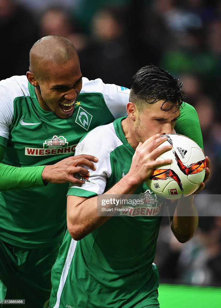 Zlatko Junuzovic of Bremen celebrates scoring the fourth goal with Theo Selassie during the Bundesliga match between Werder Bremen and Hannover 96 at...