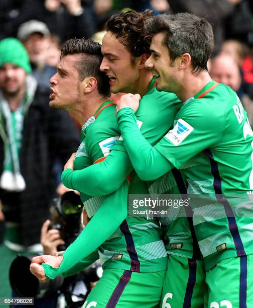 Zlatko Junuzovic of Bremen celebrates with team mates after scoring his team's first goal during the Bundesliga match between Werder Bremen and RB...