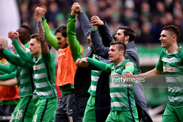 Zlatko Junuzovic of Bremen celebrates with team mates after winning the Bundesliga match between Werder Bremen and RB Leipzig at Weserstadion on...