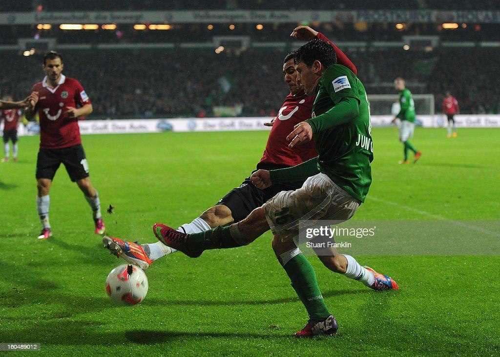 Zlatko Junuzovic of Bremen challenges for the ball with Deniz Kadah of Hannover during the Bundesliga match between SV Werder Bremen and Hannover 96 at Weser Stadium on February 1, 2013 in Bremen, Germany.